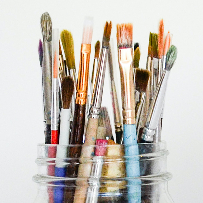 various brushes in glas