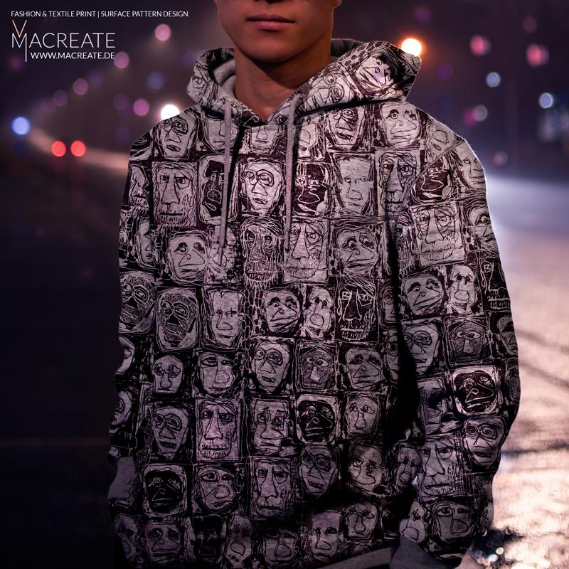 Artistic printed hoodie design by MACREATE on menswear model by night